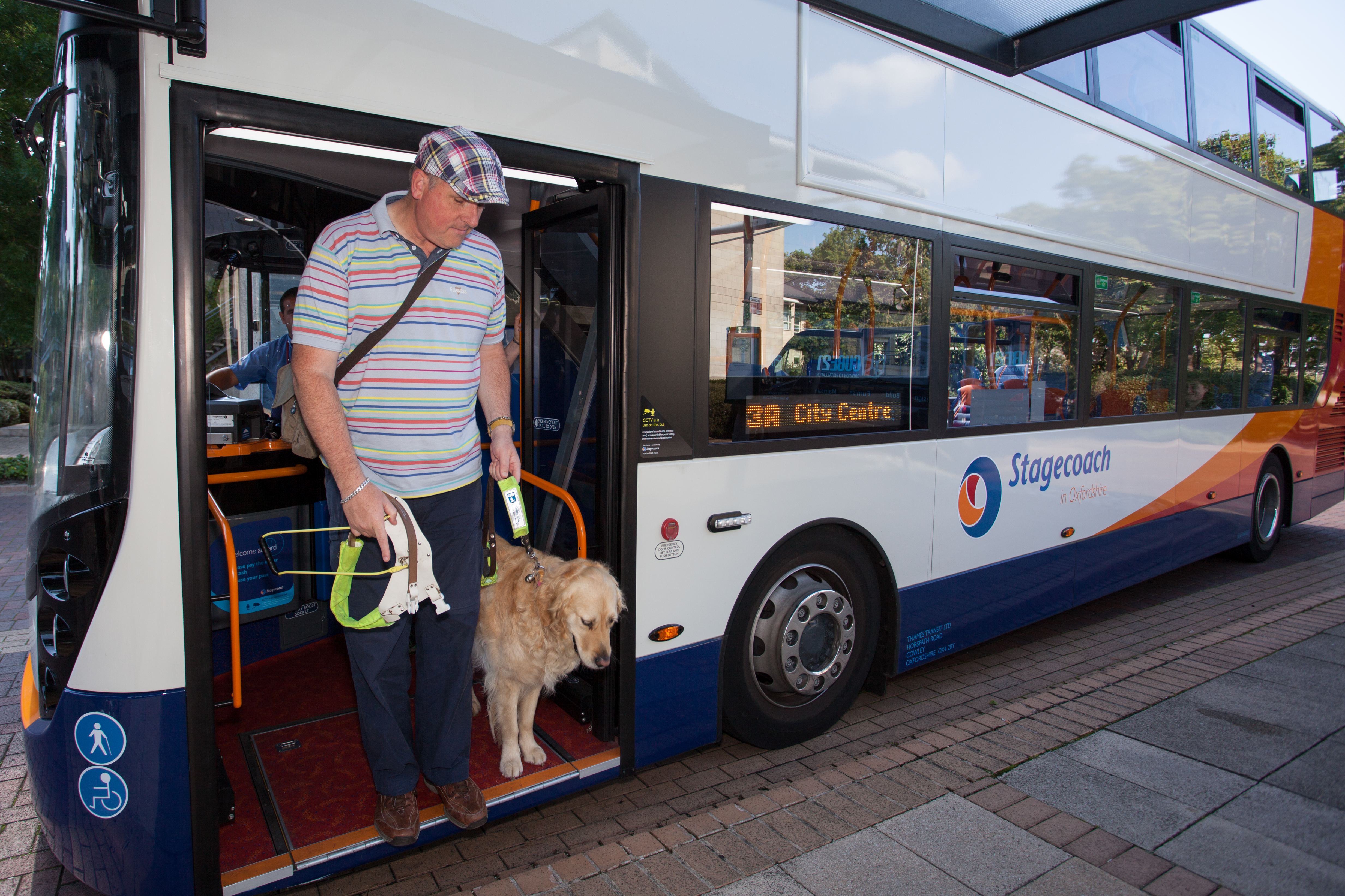 Guide Dog owner getting off bus