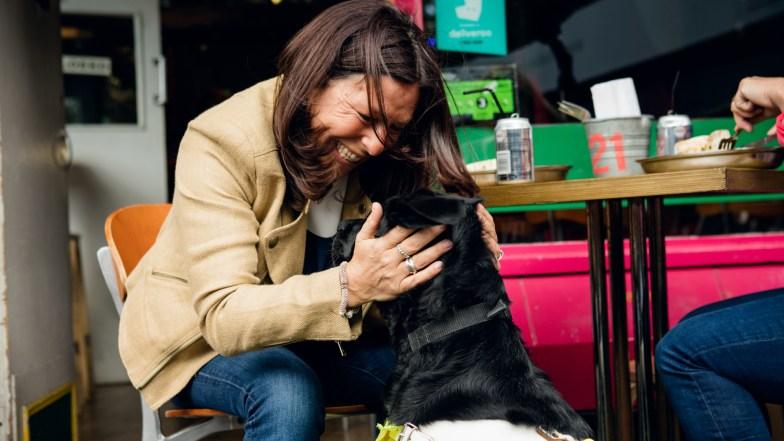 Woman hugs her guide dog