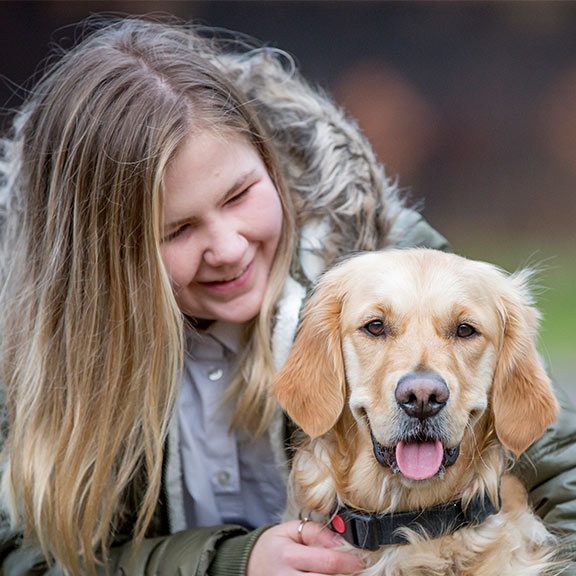 Guide dog owner Milly looking at her guide dog Libby