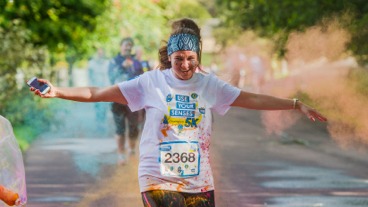 Girl running through foam