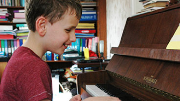 Declan playing the piano