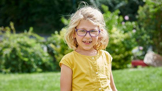 Josie smiling in her garden