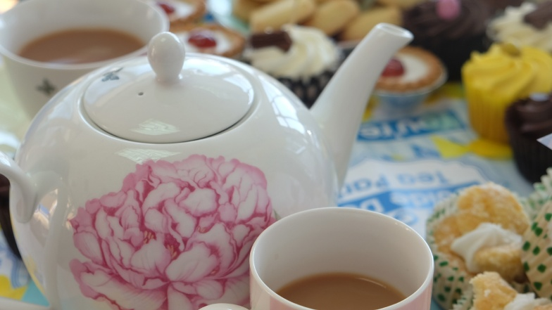 Tea pot and cakes
