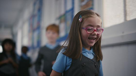 Nell smiling in her school corridor