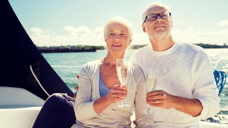 A couple sat on a yacht