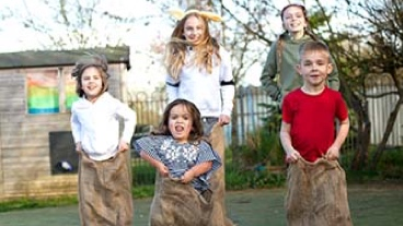 Children taking part in a sack race