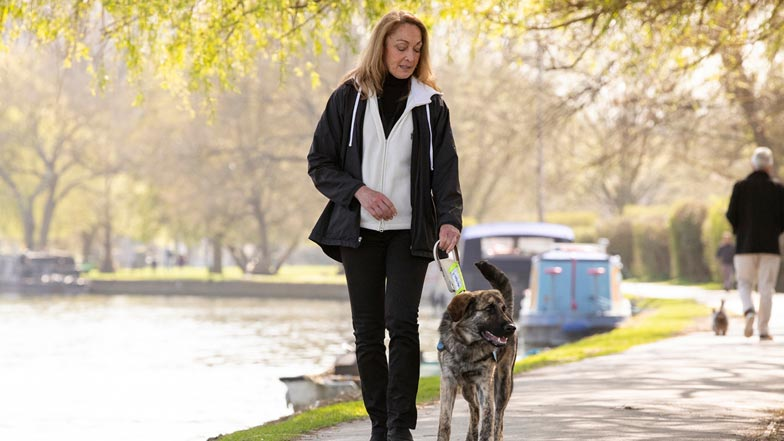 Fletcher and Jill on a walk next to a picturesque canal