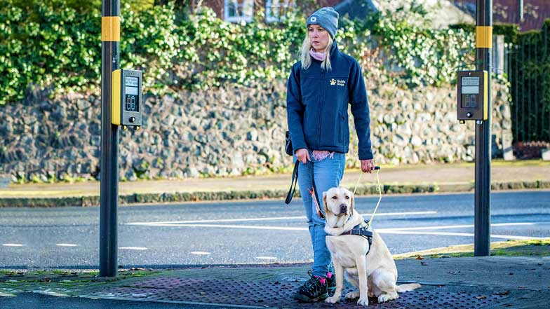 Hope and her Trainer waiting to cross a road