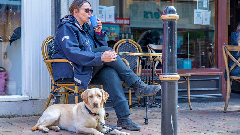 Hope and her Trainer in an outdoor café