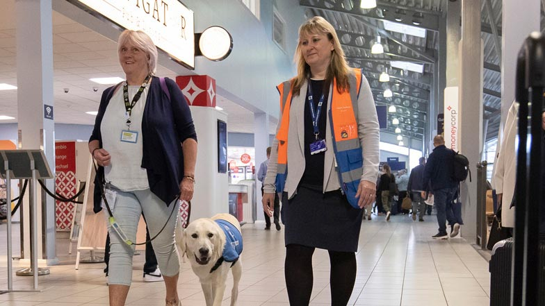 Jacki and Spirit walking through the airport