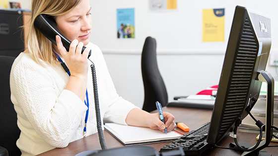 Guide Dogs Family Support Officer giving advice over the phone