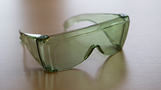 A pair of green fit over anti-glare shields on a table