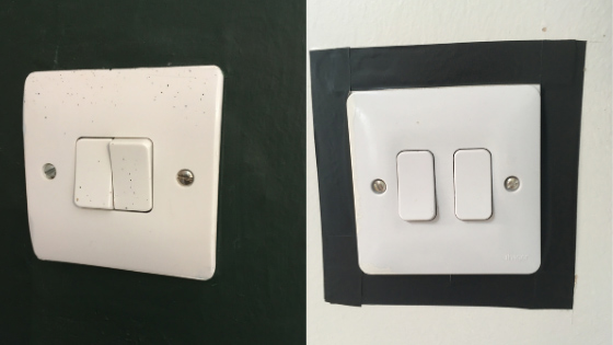 White light switch against a dark green painted wall and a white light switch on a white wall with the switch edged with black tape to help contrast