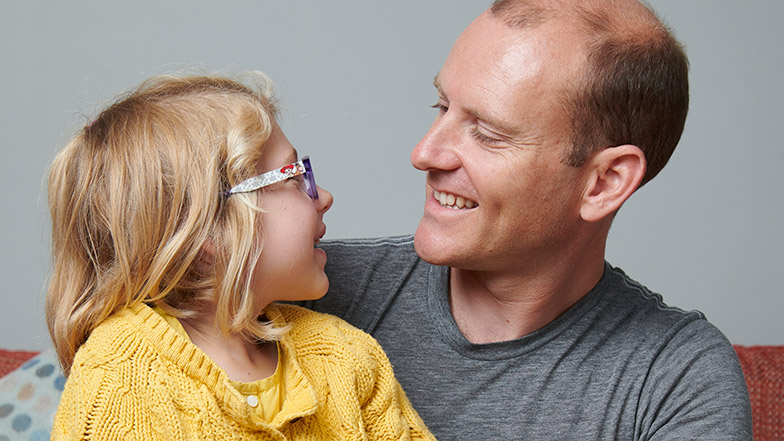 Picture of dad Roger and daughter Josie looking at each other and smiling