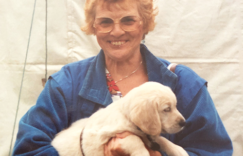 Cynthia holds her guide dog puppy